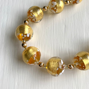 Necklace with clear crystal, gold and white spots Murano glass sphere beads on gold