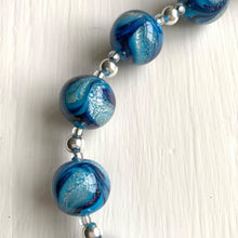 Necklace with shades of blue pastel and white gold Murano glass sphere beads on silver