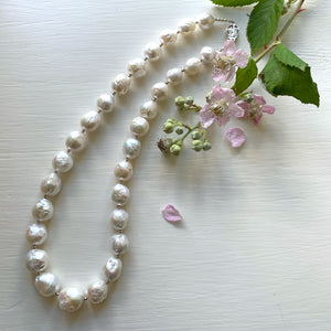 Necklace with large graduated cultured freshwater white baroque 'Kasumi' pearls