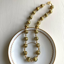 Necklace with blue appliqué over gold (it. oro bluino) Murano glass sphere beads on gold