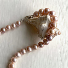 Necklace with cultured freshwater natural South Sea island near round pearls knotted