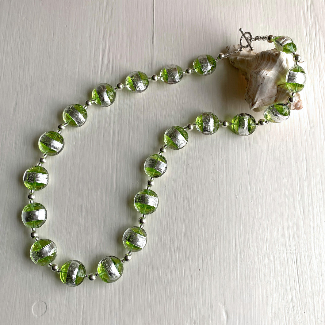 Necklace with green translucent and silver Murano glass medium lentil beads on silver