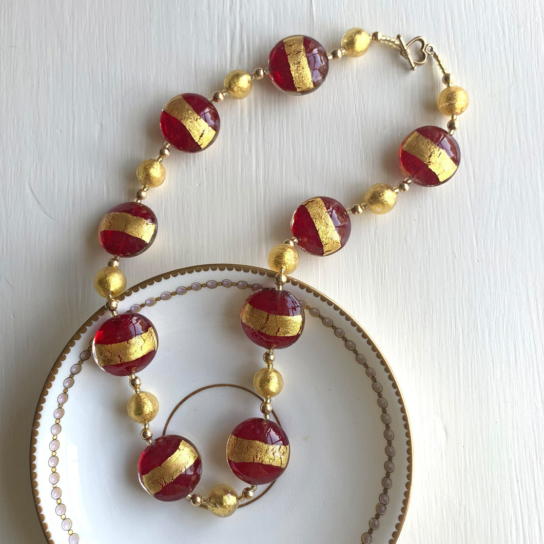Necklace with red translucent and gold large lentil and gold sphere Murano glass beads on gold