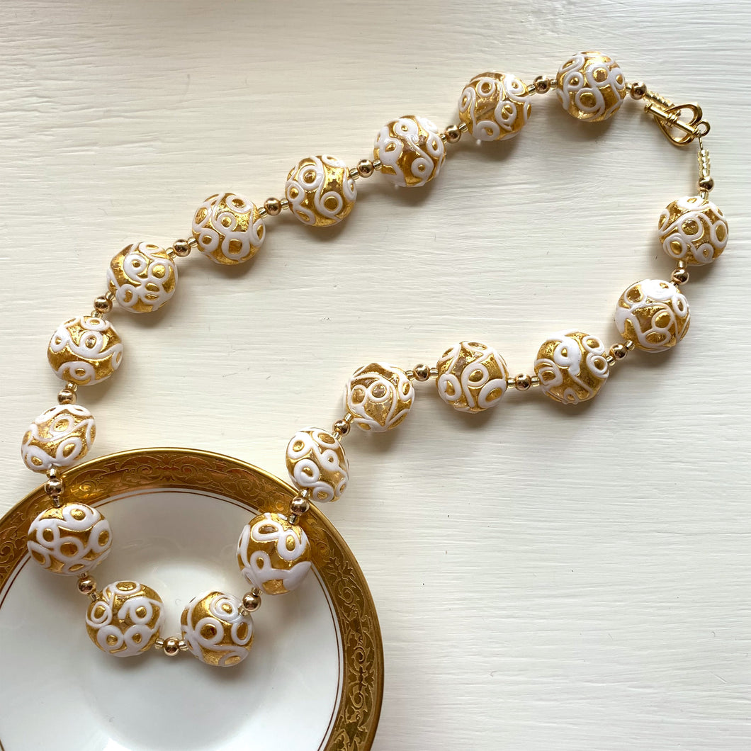 Necklace with white pastel appliqué over gold Murano glass medium lentil beads on gold