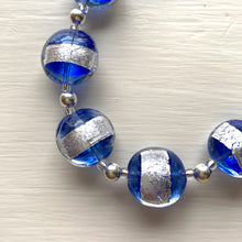 Necklace with blue translucent and silver Murano glass medium lentil beads on silver