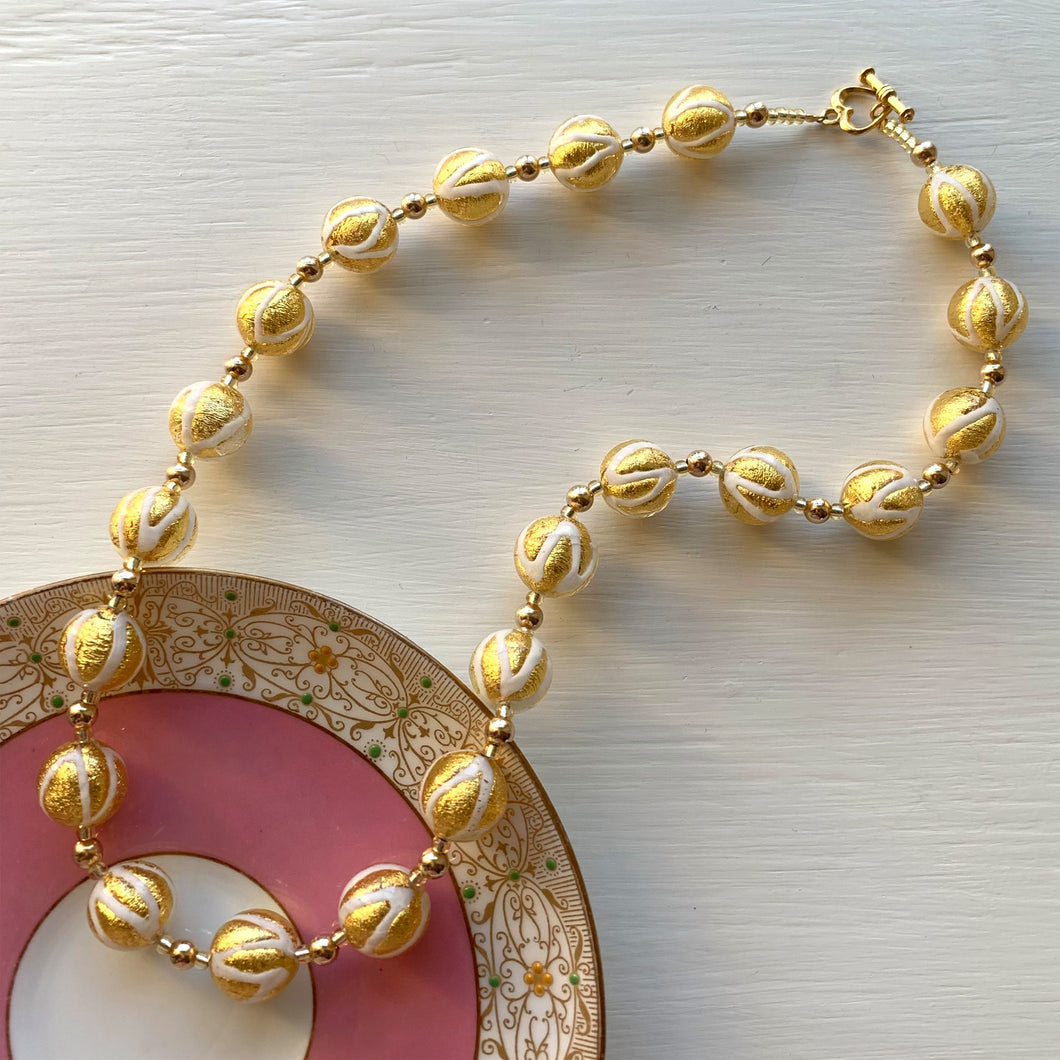 Necklace with white pastel and gold Murano glass sphere beads on gold beads and clasp