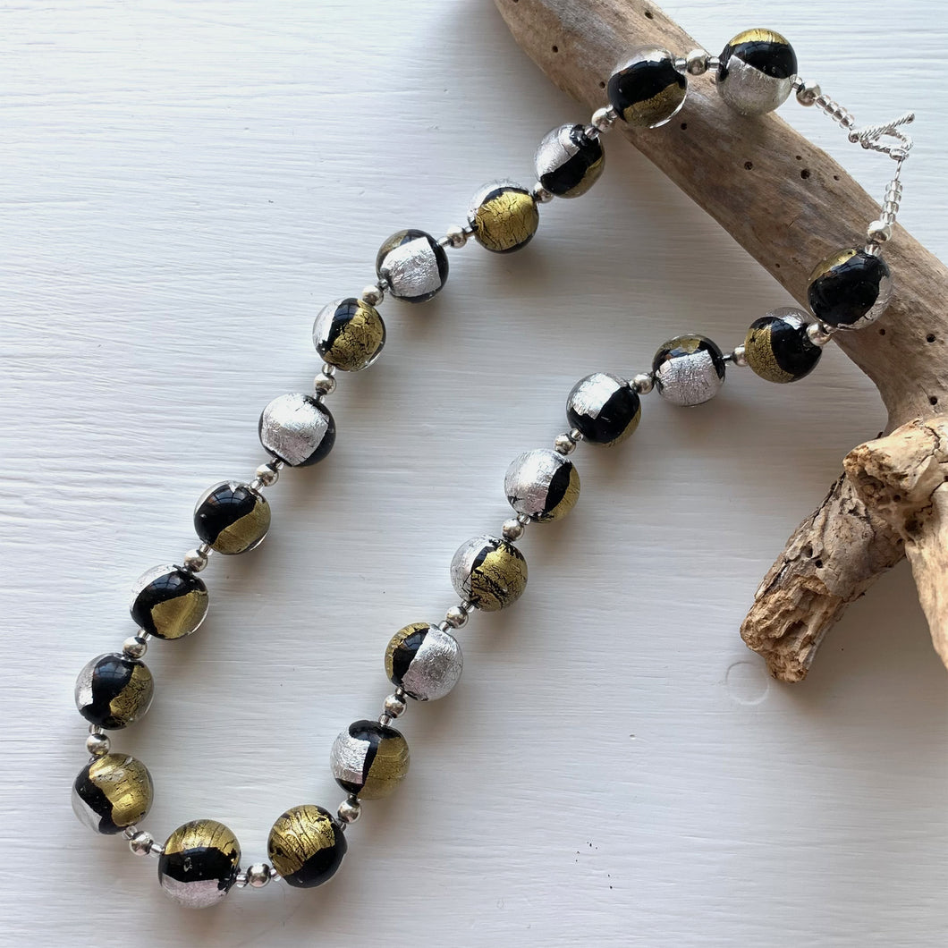 Necklace with black pastel, silver and gold Murano glass sphere beads on silver