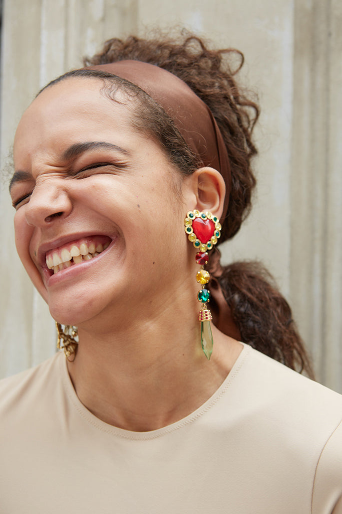 girl smiling while wearing love wins earrings from safsafu