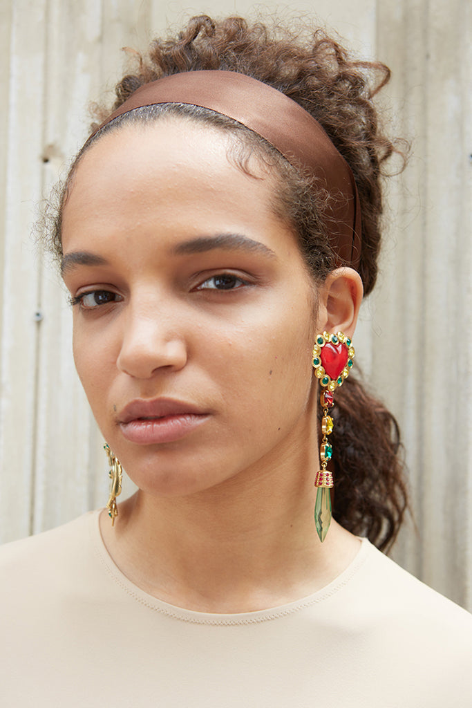 girl wearing love wins earrings from safsafu