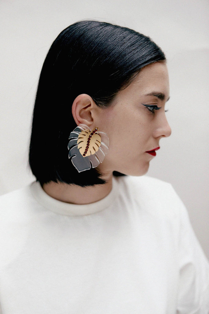 girl wearing adan's rib earrings from safsafu
