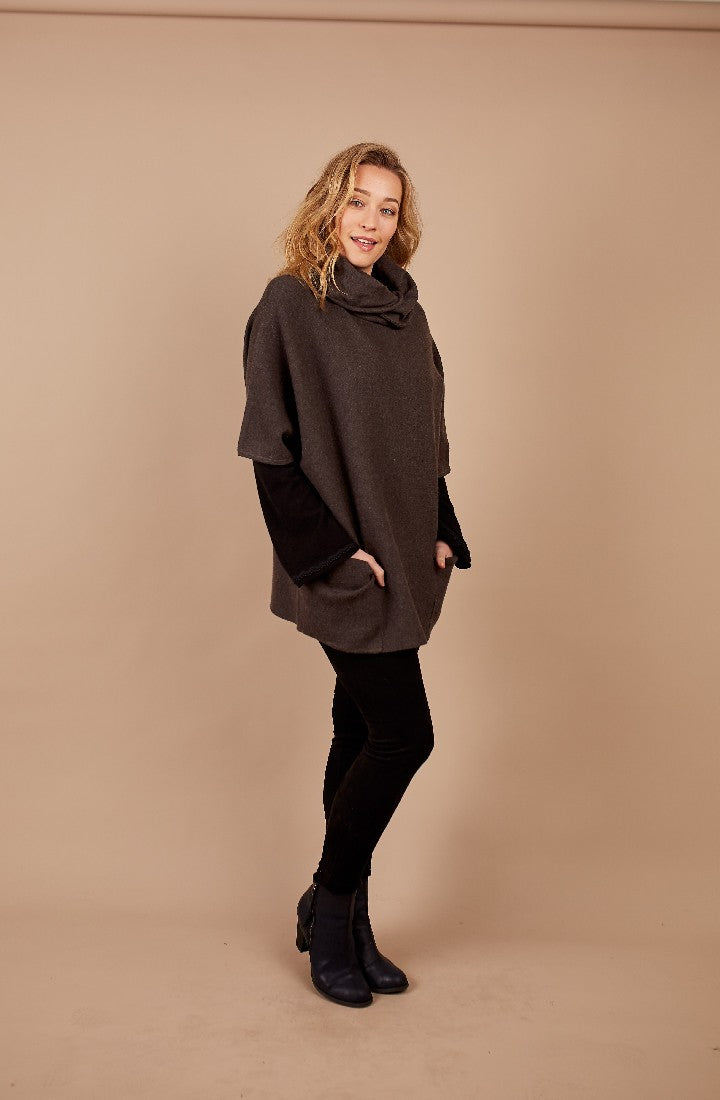 OVERSIZED TUNIC WITH ROLL NECK AND POCKETS