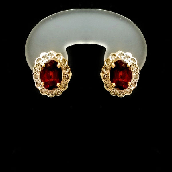 Gold Earrings with Oval Garnet and Diamonds around creating a Vintage look