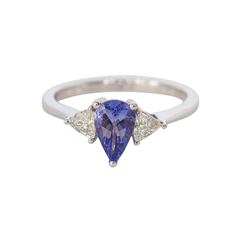 18-karat White Gold Trilogy ring with a Pear Tanzanite and Trillion Diamonds