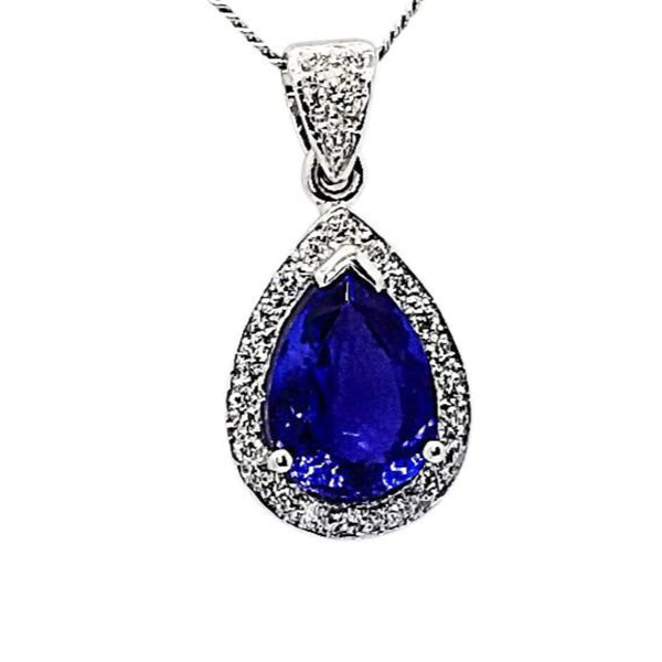 18 kt White Gold Tanzanite and Diamond Halo Pendant - Cape Diamond Exchange