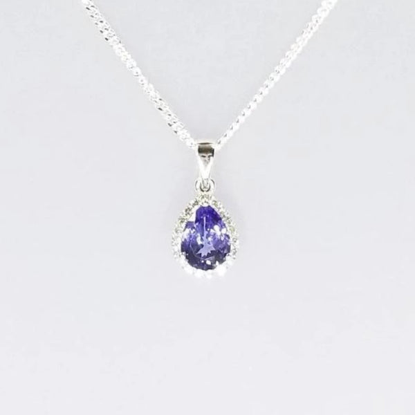 9 kt White Gold Pear Shape Tanzanite and Diamonds Pendant