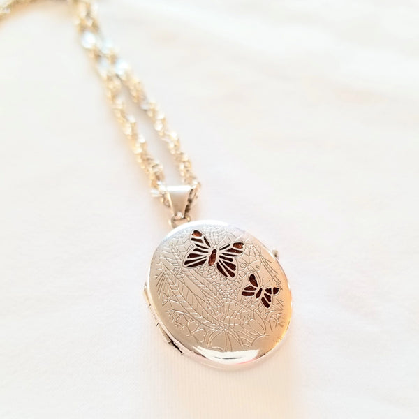 Silver Locket with butterfly decoration