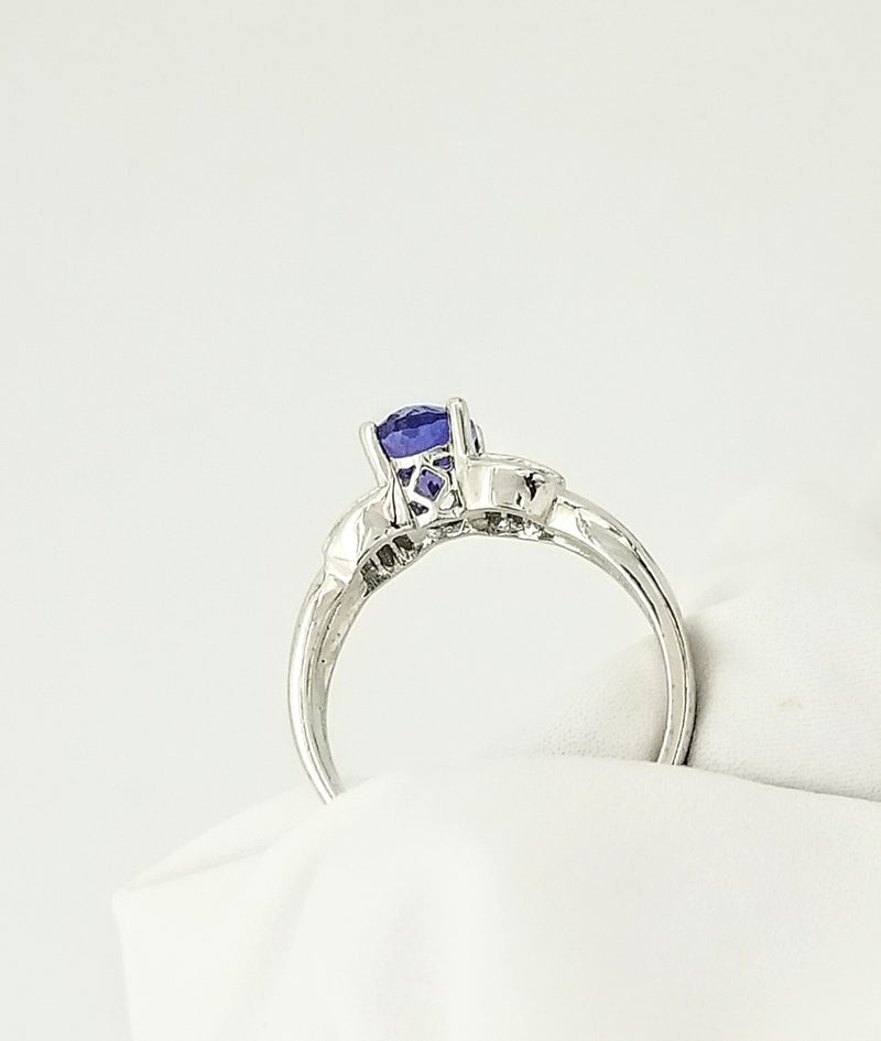 Oval Tanzanite Gold Ring decorated with Baguettes - Cape Diamond Exchange