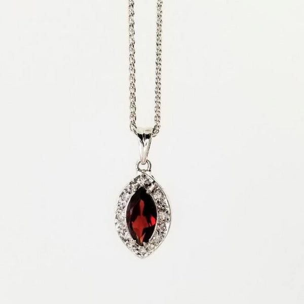 Marquise shape Red Garnet surrounded by diamods put into a pendant
