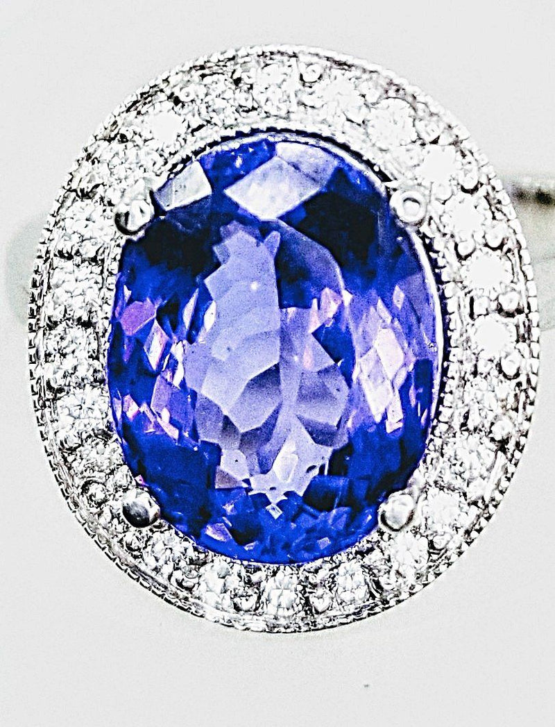 18kt White Gold Halo Oval Tanzanite Ring with Diamonds - Cape Diamond Exchange