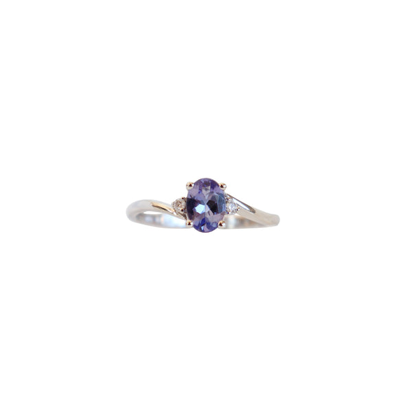 White Gold Twist Ring with an Oval Tanzanite and Diamonds - Cape Diamond Exchange
