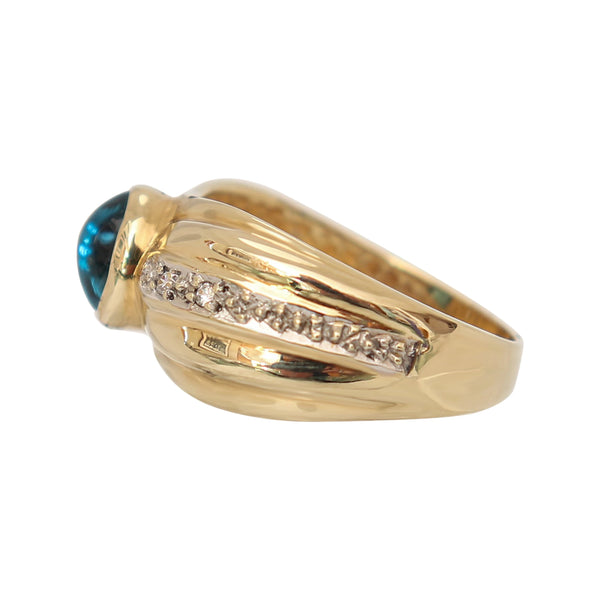 9 kt Yellow Gold Blue Topaz and Cubic Zirconia Ring