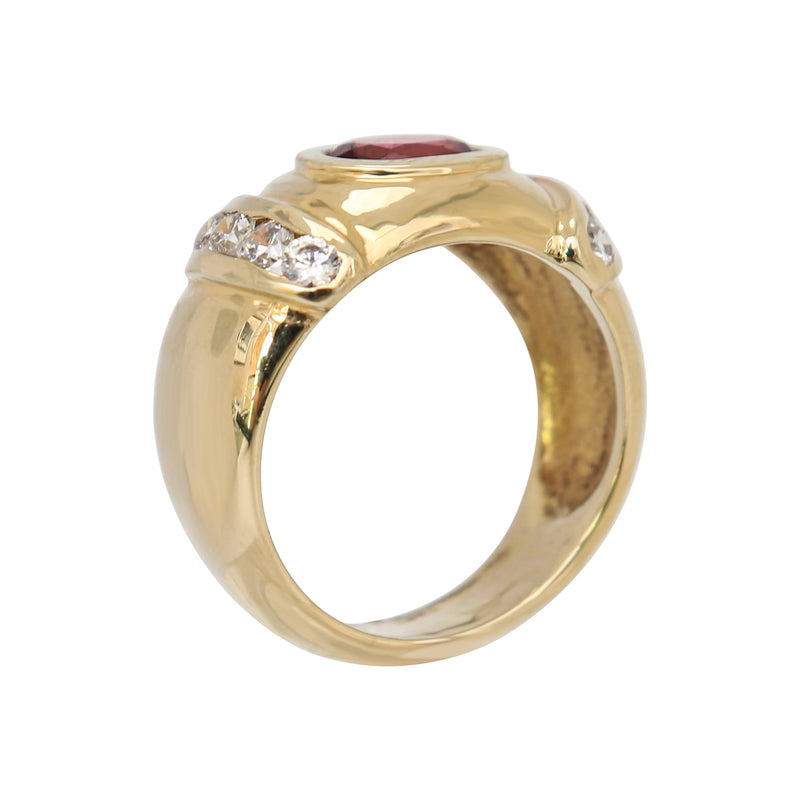 Fancy Dress Ring in 9 kt Yellow Gold Oval Garnet and Cubic Zirconias