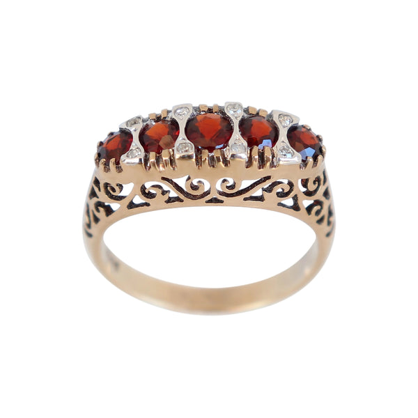 Fancy Oval Garnet and Diamond Ring set in Yellow Gold