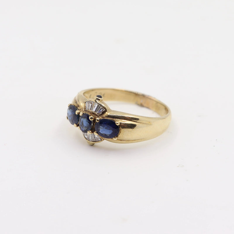 Natural Blue Sapphires set in Yellow Gold with Baguette Cut Diamonds