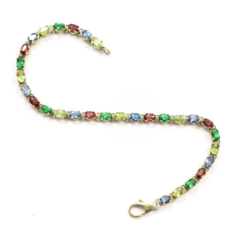 Multicolored Bracelet set with Peridot, Garnet and Topaz in Yellow Gold