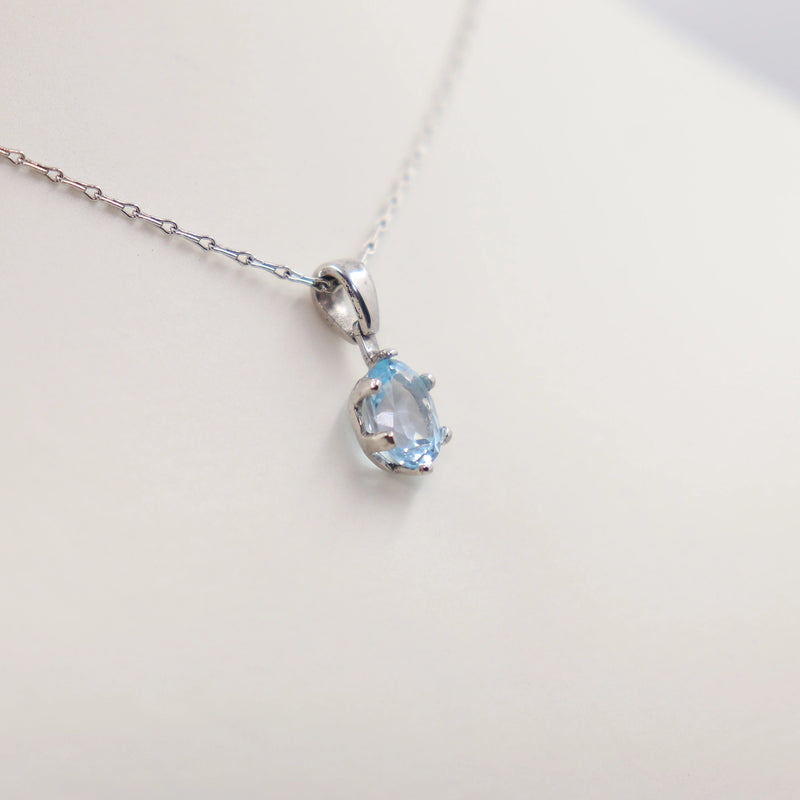 Four Claw Oval Blue Topaz Pendant set in White Gold