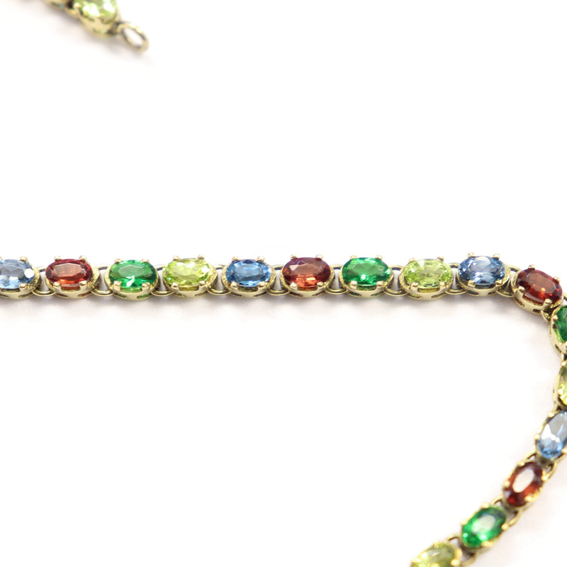 Peridot, Topaz and Garnet Tennis Bracelet set in 9 kt Yellow Gold