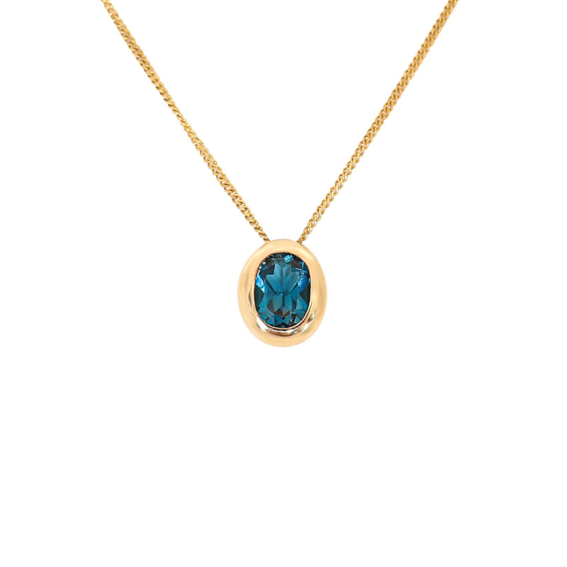 Oval Blue Topaz Pendant set in 9 kt Yellow Gold