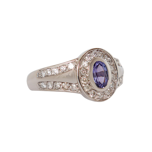 18 kt White Gold Split Band Ring with Oval Tanzanite and Channel-set Diamonds - Cape Diamond Exchange