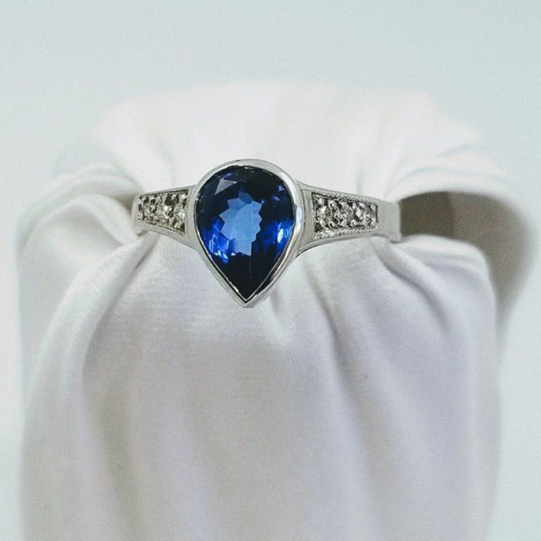 Pear Shape Center Tanzanite Stone Tube setting Ring