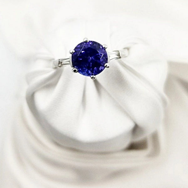 White Gold Ring with a Round Tanzanite center stone and Baguettes