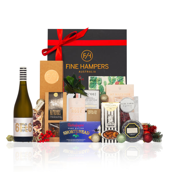Black Gift box with red seasonal ribbon with Fine Hampers written on it with gourmet foods