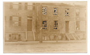 Photo postcard of building damaged during Hamilton, Ontario Street Railway strike