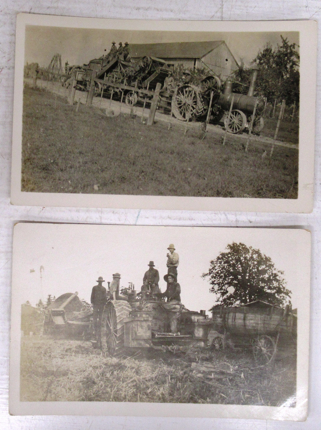 Two photo postcards of steam tractors in Northern Ontario