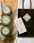 Gift pack of homemade soy candles, decorative match box, and gift bag