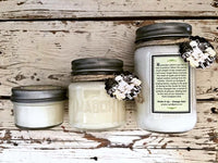 Three sizes of homemade lilac soy candles in decorative mason jars