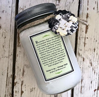 Homemade lilac soy candle in decorative mason jar