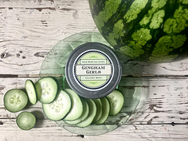 Homemade cucumber melon soy candle in decorative mason jar