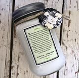 Homemade hazelnut soy candle in decorative mason jar