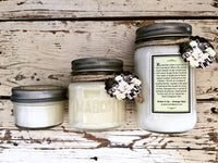 Three sizes of homemade pumpkin soufflé soy candles in decorative mason jars