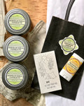 Gift pack of homemade soy candles, decorative match box, and lotion bar