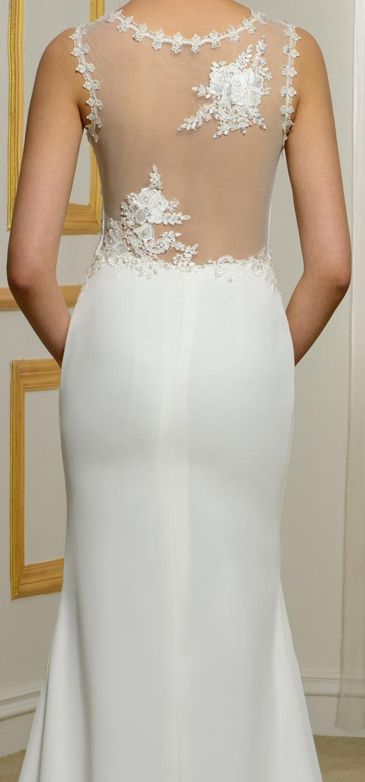 Style 1460. Size 10 fit and flare wedding gown with mesh back