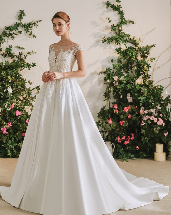 71113 Satin princess skirt. Applique bodice with capped sleeves.