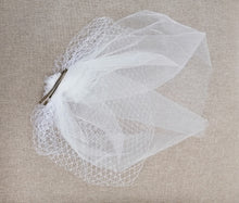 BBFAC6 Elegant off white fascinator with net and soft tulle.