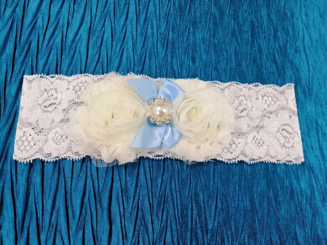 BBG5 Blue and white stretch lace bridal garter with applique flowers and blue satin ribbon