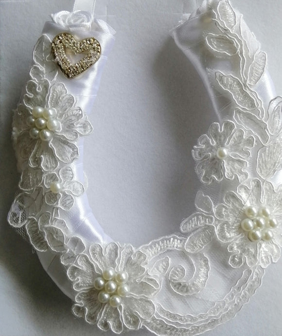 BBHS19 white satin bridal horseshoe with pearls and light ivory lace embellishments.